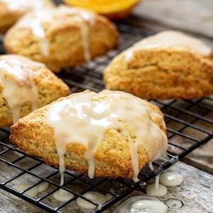 orange scones dripping with glaze