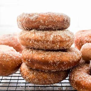 a stack of cinnamon coated donuts