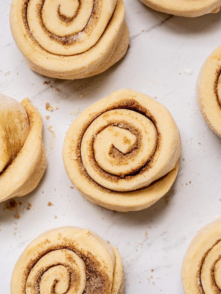 brioche dough spirals on a white bench