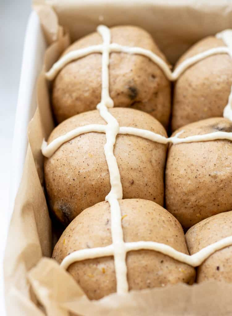 risen hot cross buns with piped crosses