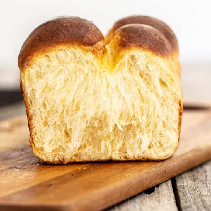 up close brioche bread on a wooden board