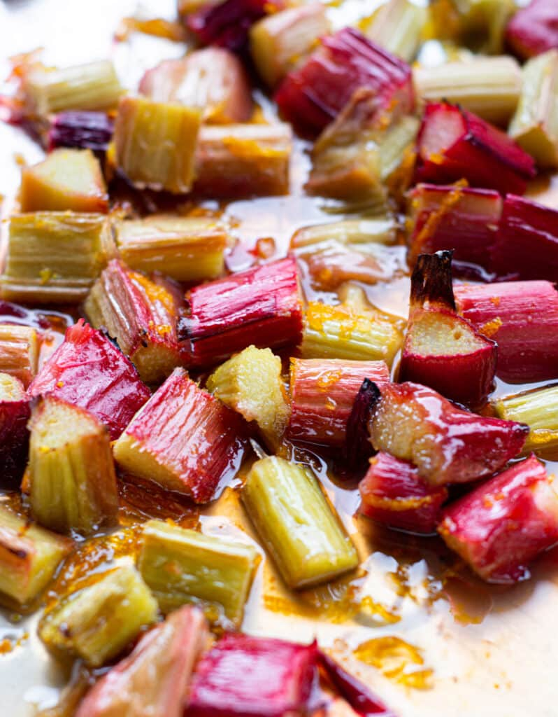 roasted rhubarb pieces in glistening orange juice