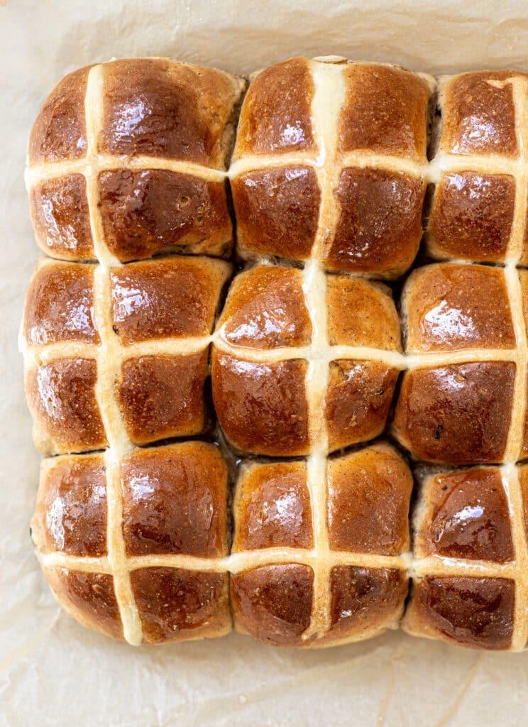 9 hot cross buns on parchment paper