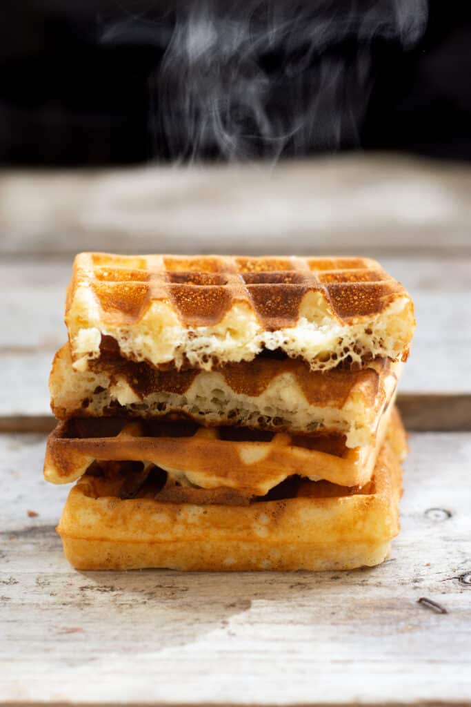 a stack of steaming waffles