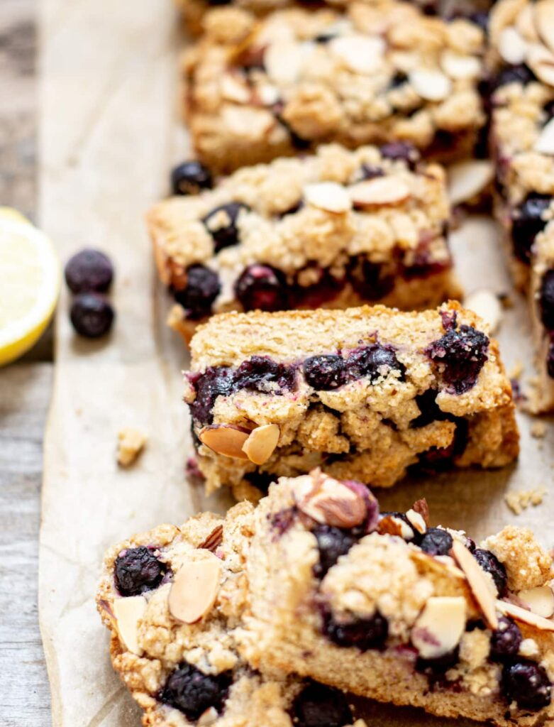 sliced blueberry pie bars on brown paper