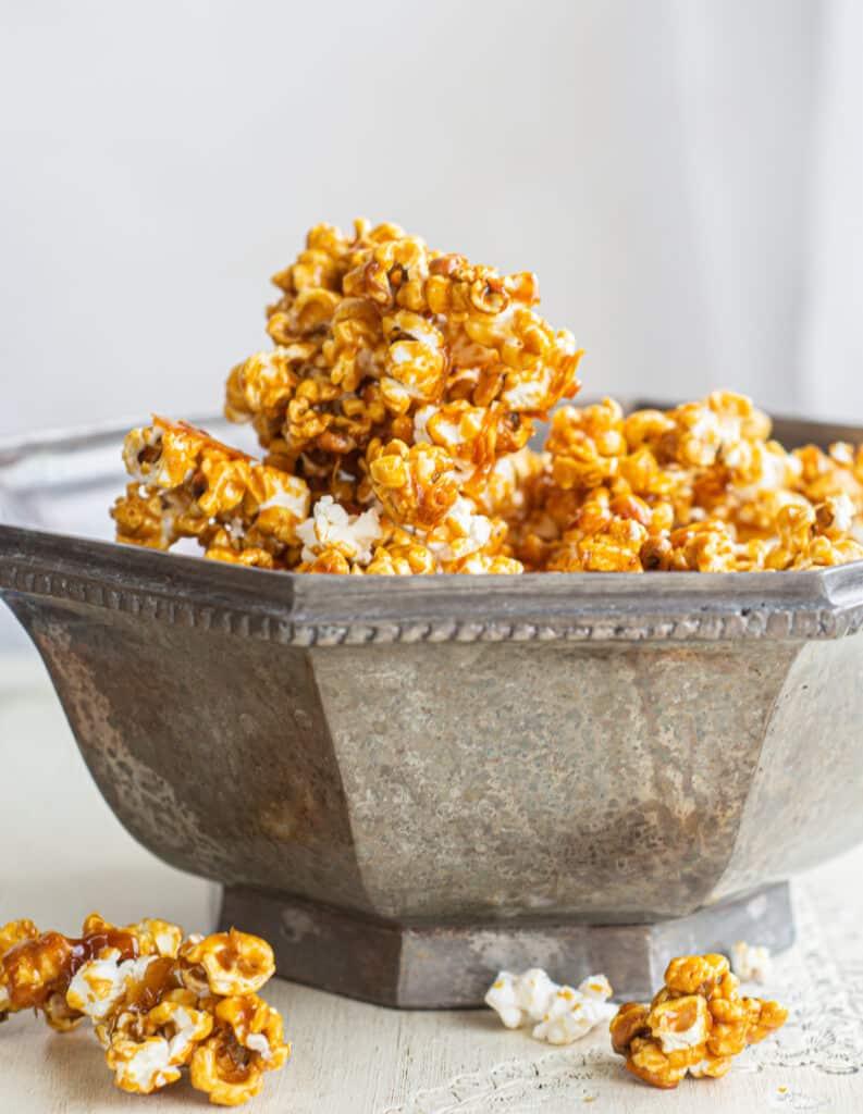 a silver bowl of caramel corn