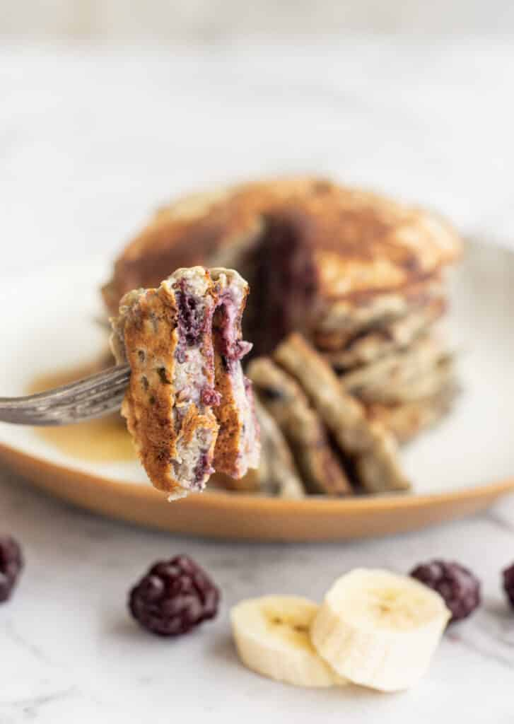 berry banana pancakes on a fork